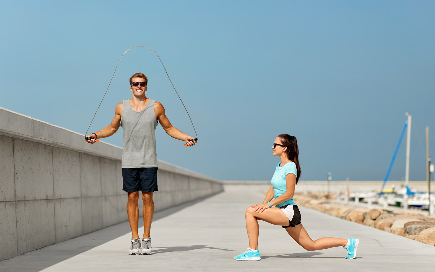 Fitness enthusiasts using RPM speed rope on a beach