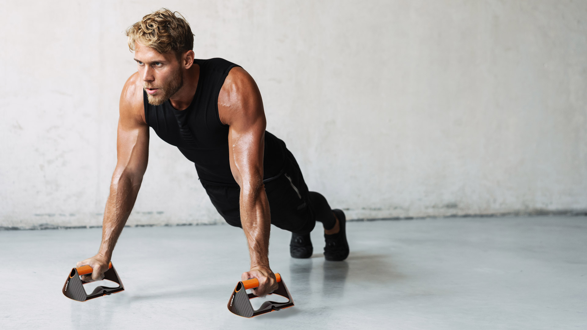 fitness athlete using push-up handles to improve performance home-gym equipment