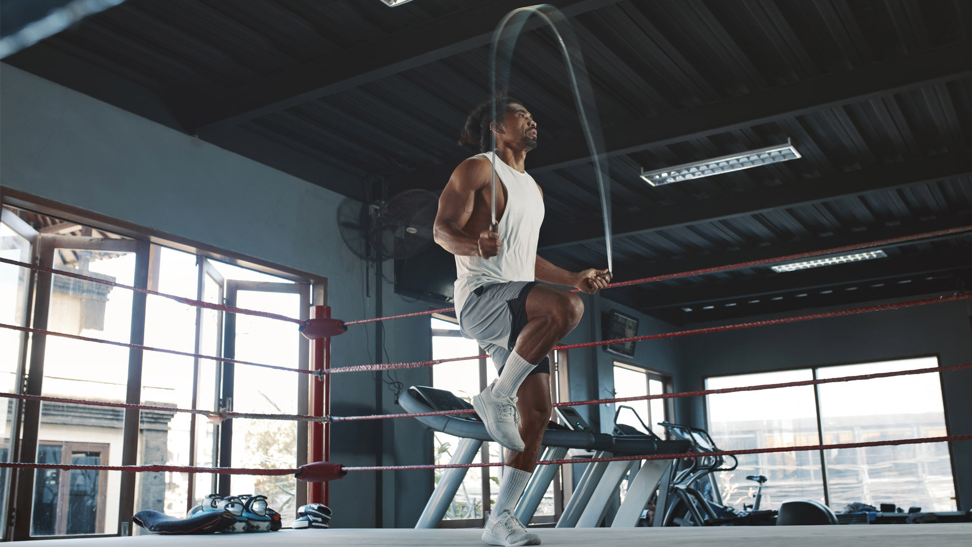 MXT athlete using rpm speed rope at home-gym wearing nike shoes